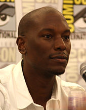 Tyrese Gibson looks away from the camera.