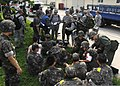 U.S. Air Force medical staff with the 8th Fighter Wing and the 38th Fighter Group coordinate plans to transport simulated casualties during exercise Beverly Midnight 13-3 at Kunsan Air Base, South Korea, Aug. 7 130807-F-LD870-165.jpg