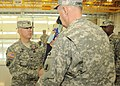 U.S. Army Col. Michael Berry, left, receives the 722nd Troop Command Brigade, Delaware Army National Guard colors from Command Sgt. Maj. Bill Campbell for the last time as commander of the brigade during 131207-Z-GL773-842.jpg