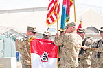 U.S. Army Col. Nicholas Katers, left, and Command Sgt. Maj. Kevin Bryan, the command team for the 555th Engineer Brigade, case their brigade flag during a transfer of authority ceremony at Bagram Airfield 131002-A-ZZ999-003.jpg