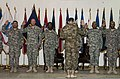 U.S. Army Lt. Gen. Jeffrey Talley, back to camera, the chief of the Army Reserve, administers the oath of enlistment to 19 Soldiers at Camp Arifjan, Kuwait, April 23, 2013 130423-A-KU062-313.jpg