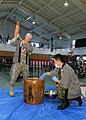 U.S. Army Maj. Gen. James C. Boozer Sr., the commanding general of U.S. Army Japan and I Corps, pounds clumps of sticky rice with a wooden mallet, turning it into mochi, a popular type of rice cake, during 131218-A-OO766-104.jpg