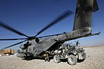 U.S. Marines with the 3rd Battalion, 7th Marine Regiment and with Marine Heavy Helicopter Squadron (HMH) 462 load gear on a CH-53E Super Stallion helicopter in Kajaki, Helmand province, Afghanistan, Oct. 7 131007-M-SA716-057.jpg