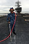 U.S. Navy Airman Daniel Lopez cleans pad eyes on the flight deck of the aircraft carrier USS Ronald Reagan (CVN 76) Aug. 26, 2013, in San Diego 130826-N-HI324-031.jpg