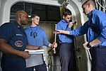U.S. Sailors perform maintenance on a quick-acting watertight door in the hangar bay of the aircraft carrier USS Harry S. Truman (CVN 75) March 8, 2014, in the Gulf of Oman 140308-N-CC806-051.jpg