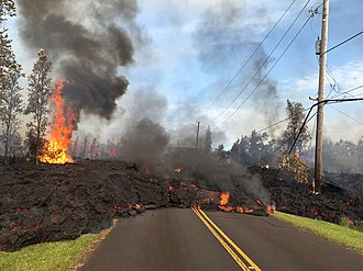 Kīlauea - Lava from a fissure slowly advanced to the northeast on Hoʻokupu Street in Leilani Estates subdivision (May 5, 2018)