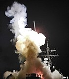 USS Barry (DDG-52) launching a Tomahawk missile in support of Operation Odyssey Dawn - Cropped