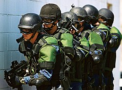 Many law enforcement agencies have heavily armed units for dealing with dangerous situations, such as these U.S. Customs and Border Protection officers.