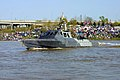 US Navy 030412-N-9824J-001 Louisville area residents lined the riverbanks of the Ohio River as two U.S. Navy Mark V (MK-V) Special Operations Crafts (SOC) departed their pier to get in place for their special operations demons.jpg