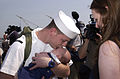 US Navy 030529-N-1522S-005 Electricians Mate 3rd Class Blake Henry assigned to the amphibious assault ship USS Nassau (LHA 4), embraces his 10 week old son for the first time.jpg