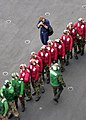 US Navy 030710-N-6213R-019 Photographer's Mate 2nd Class Jayme Pastoric from Chardon, Ohio, photographs flight deck crewmembers during a flight deck fire fighting training exercise aboard USS John C. Stennis (CVN 74).jpg