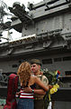 US Navy 030915-N-4309A-006 Wendy Cordero was selected to get the first kiss from Seargeant Jason Reyes, after returning from an eight month cruise aboard USS Carl Vinson (CVN-70).jpg