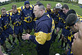 US Navy 031022-N-6477M-384 U.S. Navy rugby team head coach, Cmdr. Don Sheehan, assigned to Naval Air Station (NAS) Patuxent River, Md. instructs the team before their first match against the U.S. Air force.jpg