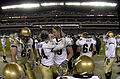 US Navy 031206-N-0399H-526 Navy linebacker Lane Jackson (44) and offensive left tackle Nick Wilson (79) congratulate each other in the final moments of the 104th Army Navy game.jpg