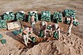 US Navy 041116-N-5386H-005 Seabees, assigned to Naval Mobile Construction Battalion Two (NMCB 23), fill approximately 300 sand bags at a Coalition Force camp in Al Anbar Province, western Iraq.jpg