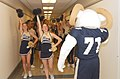 US Navy 041202-N-2568S-001 U.S. Naval Academy cheerleaders and mascot Bill the Goat kick off a pep-rally in the halls of the Pentagon.jpg