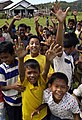 US Navy 050107-N-6074Y-122 Indonesian children of a village just inland from the coast of Sumatra, Indonesia, celebrate as food and water are flown to their village by a U.S. Navy MH-60S Knighthawk helicopter.jpg