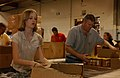 US Navy 050416-N-5621B-043 Chief Photographer's Mate Bill Gowdy, right, stationed at Command Combat Camera Group Pacific (CCG), and his daughter fill food boxes during a volunteer project at the San Diego Food Bank.jpg