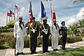 US Navy 050628-N-7293M-014 Service members stand at attention as part of a joint-service color guard that was representing the U.S. military during a historic visit by the royal family of Japan.jpg