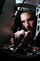 US Navy 060626-N-9723W-006 Aviation Electronics Technician Airman Cody Matheny adjusts a receiver inside an electronics compartment of an F-A-18C Hornet.jpg
