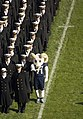 US Navy 061202-N-5319A-001 Assisted by the Navy's mascot, a parade of Midshipmen from the U.S. Naval Academy march onto Lincoln Financial Field during opening ceremonies for the 107th playing of the Army vs. Navy football.jpg