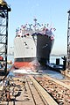 US Navy 061206-N-9195K-039 Military Sealift Command (MSC) advanced auxiliary dry cargo-ammunition ship USNS Alan Shepard (T-AKE 3) slides backwards into San Diego Bay during a christening ceremony.jpg