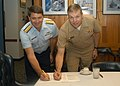 US Navy 070111-N-2789G-010 Left, Rear Adm. Richard Houk, commander, 13 Coastguard District, and Rear Adm. William French, commander, Navy Region Northwest, signs a Memorandum of Understanding.jpg