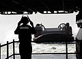 US Navy 070327-N-1831S-017 A Sailor direct a Landing Craft Air Cushion (LCAC) into the well deck of amphibious assault ship USS Kearsarge (LHD 3).jpg