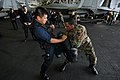 US Navy 070620-N-7883G-014 Aviation Machinist's Mate 3rd Class Francis Falguera practices knee-kicking techniques on a target shield held by Master-at-Arms 2nd Class Charles Gibbs aboard USS Kitty Hawk (CV 63).jpg