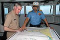 US Navy 070904-N-1332Y-136 Rear Adm. Terry Blake, commander of Carrier Strike Group 11, discusses operations with Rear Adm. Robin Dhowan, commander-in-chief of the Indian Eastern Fleet, aboard Indian Navy aircraft carrier INS V.jpg