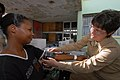 US Navy 070917-N-8704K-029 Cmdr. Sally Jarvis, attached to Military Sealift Command hospital ship USNS Comfort (T-AH 20), checks the vital signs of a patient at the Arima Health Facility.jpg