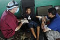 US Navy 080814-N-3595W-147 Lt. Cmdr. Michael Hill, a dentist embarked aboard the amphibious assault ship USS Kearsarge (LHD 3), gives a dental exam to a Nicaraguan citizen from Tuapi, Nicaragua.jpg