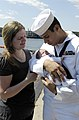 US Navy 080821-N-8467N-013 Robert Rojas holds his 2-week-old daughter for the first time.jpg