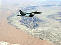 US Navy 081009-N-7665E-002 An F-A-18C Hornet transits over the desert of Southern Afghanistan.jpg
