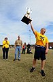 US Navy 081206-N-5328N-165 Navy flag football team captain Marine Corps Capt. Audie Cooper holds the Army-Navy trophy.jpg