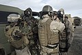 US Navy 090127-N-5821P-022 Sailors assigned to Explosive Ordnance Disposal Unit (EODMU) 8 help each other don M-45 gas masks and joint service lightweight integrated suit technology suits during a chemical warfare training exer.jpg