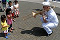 US Navy 090825-N-2600H-192 A Sailor assigned the U.S. 7th Fleet Band plays the trombone for children during a community service project to restore the historic Japanese battleship Mikasa.jpg