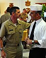US Navy 090926-N-9552I-009 Vice Adm. Michael C. Vitale, commander of Navy Installations Command, greets an Italian galley worker at Naval Air Station Sigonella.jpg
