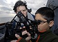 US Navy 091214-N-9520G-324 Quartermaster Seaman Samantha R. Elwell teaches the son of Cmdr. Michael Misiewicz istance and position using a stadimeter.jpg