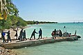 US Navy 100122-N-0202T-077 Sailors assigned to the guided-missile cruiser USS Bunker Hill (CG 52) distribute water in Gonave Island, Haiti.jpg