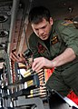 US Navy 100304-N-9116S-153 Naval Air Crewmen 2nd Class Cody J. Cox loads a 600-round ammo can in an MH-60S Sea Hawk helicopter.jpg