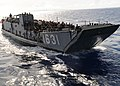US Navy 101001-N-4743B-053 A landing craft utility with embarked Sailors and Marines enters the well deck of USS Essex (LHD 2) as part of a non-com.jpg