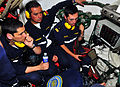 US Navy 101027-N-8824M-092 Lt. Rafael Castillo, left, Lt. Cristian Ahumada, and Lt. Patricio Puyol, assigned to the Chilean navy diesel electric s.jpg