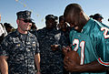 US Navy 101109-N-7948C-094 Miami Dolphin cornerback Vontae Davis signs a football for Chief Warrant Officer 2nd Mike Puit during a tour of the guid.jpg