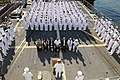 US Navy 101119-N-5812W-004 Sailors aboard the guided-missile destroyer USS Roosevelt (DDG 80) bow their heads in respect to Hospital Corpsman 2nd C.jpg
