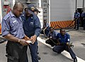 US Navy 110407-N-HI707-891 Damage Controlman 1st Class Derrick Harney teaches a Nigerian sailor about the responsibilities of an on scene leader du.jpg