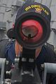 US Navy 110706-N-IO627-119 Gunner's Mate 1st Class Robert Jackson aims an MK 38 Mod 2 25 mm machine gun aboard USS Curtis Wilbur (DDG 54).jpg