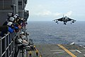 US Navy 110925-N-WA347-526 Aviation boatswain's mates watch from Vulture's Row as an AV-8B Harrier assigned to Marine Attack Squadron (VMA) 214 lan.jpg