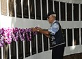 US Navy 111111-N-UK333-050 Retired Submarine veteran Yeoman 1st Class Al Shoehigh places a lei on the plaque.jpg