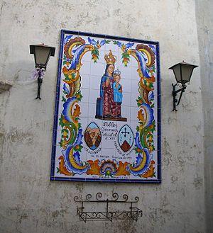 Ilercavonia - Virgin Mary on the wall of the Vallibona main church honoring the traditional bonds between the towns of Vallibona (Valencian Community) and Pena-roja (Peñarroya de Tastavins) over the hills in Matarranya, Aragon.